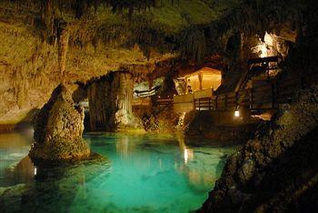 Indoor pool grotte  Grotto Bay Beach Resort in Baileys Bay - Hotel Booking Offers ...