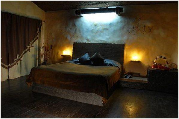 guhantara resort hotel rooms rates photos deals map